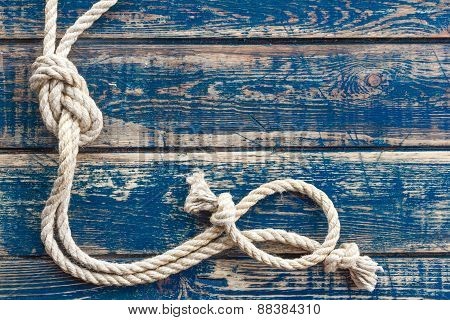 Wooden background with marine knot