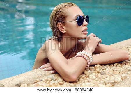 Beautiful Woman With Blond Wet Hair In Aviator Sunglasses
