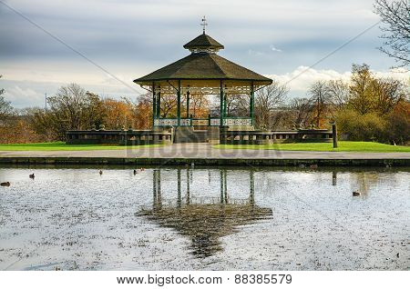 Bandstand and pond in Huddersfield, England.