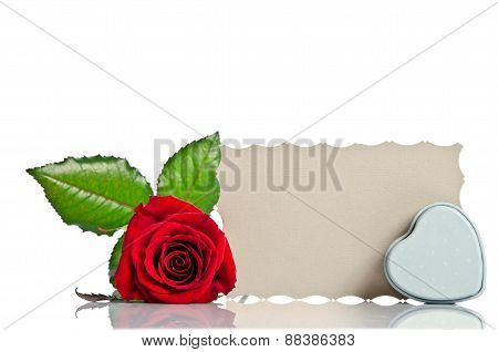 Red Rose With  Box In The Shape Of A Heart And Blank Gift Card For Text On White Background