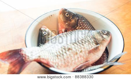 Fishes In The Dish Or Bowl On The Table In The Kitchen
