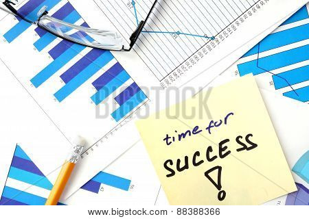 Papers with graphs and words time for success.