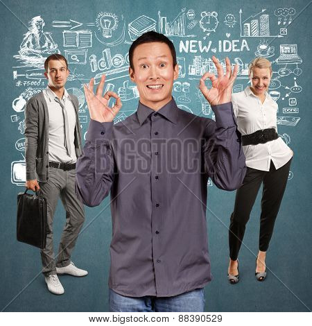 Teamwork concept. Asian man shows OK with both hands
