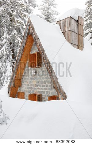 Wooden Houses Buried In Snow Due To High Snow Blizzard