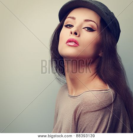 Sexy Makeup Woman In Cap Posing With Pink Lipstick