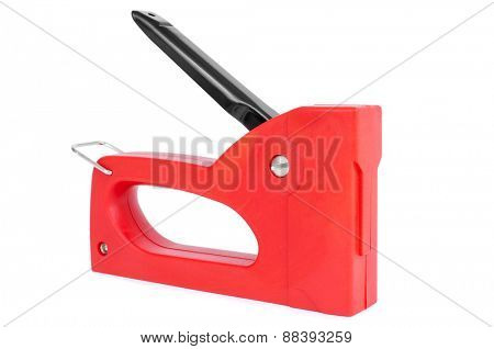 a red manual staple gun isolated on a white background