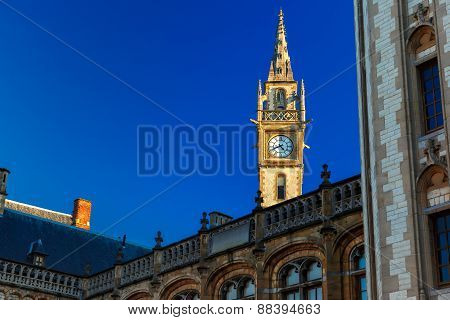 Clock tower at Quay Graslei in Ghent town, Belgium