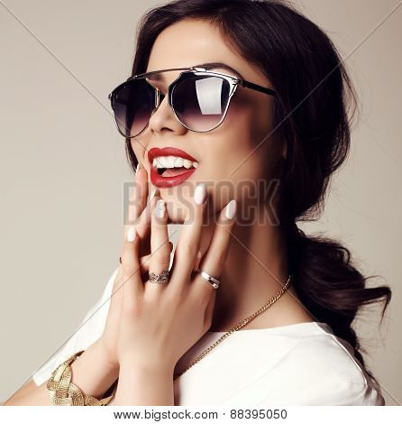 Beautiful Smiling Girl With Dark Hair With Sunglasses And Bijou