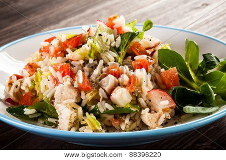 Roasted white meat, rice and vegetables