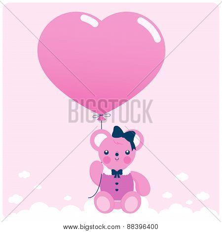 Teddy bear and pink balloon