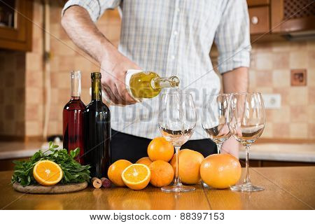 Man pours white wine