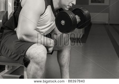 Man doing workout with heavy dumbbell.
