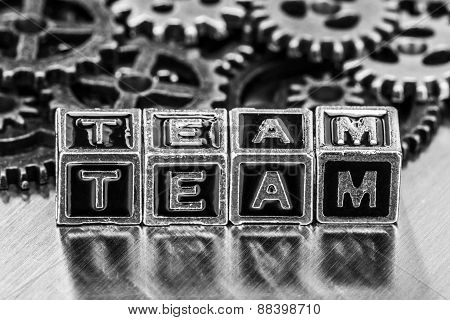 Team Word With Cog Wheels