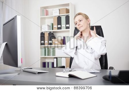 Exhausted Adult Woman Doctor Holding Her Nape