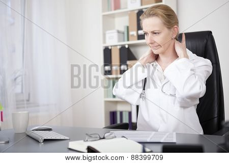 Tired Doctor Massaging The Back Of Her Neck