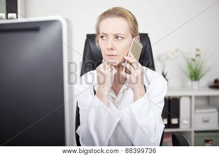 Serious Female Doctor On Phone And Looking To Left