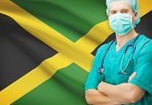picture of jamaican flag  - Surgeon with national flag on background  - JPG