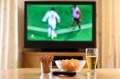 Television, Tv Watching (football, Soccer Match) With Snacks Lying On Table poster