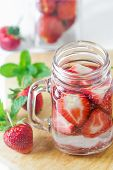 stock photo of infusion  - Mug delicious refreshing drink of strawberry on wooden infused water - JPG