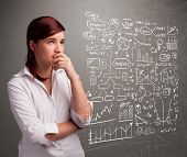 pic of anal  - Pretty young woman looking at stock market graphs and symbols - JPG