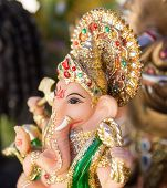 picture of ganesh  - Ganesh elephant god figure closeup focused on face - JPG