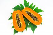 image of pawpaw  - Haft cut papaya fruit and papaya leaf isolated over white background - JPG