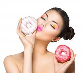 stock photo of donut  - Beauty fashion model girl taking sweets and colorful donuts - JPG