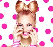 stock photo of nail-art  - Beauty fashion model girl with funny bow hairstyle - JPG