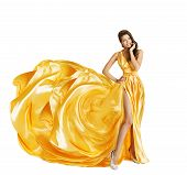 stock photo of white gown  - Woman in Yellow Art Silk Dress Surprised Girl Looking Sideways Gown Cloth Fabric as Flower Beauty Model Isolated over White - JPG