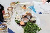 stock photo of passover  - seder table with passover plate and special meal with egg parsley - JPG