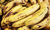 picture of stall  - bunch of ripe organic bananas at market stall - JPG