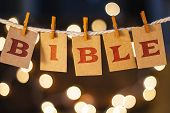 picture of bible verses  - The word BIBLE printed on clothespin clipped cards in front of defocused glowing lights. ** Note: Visible grain at 100%, best at smaller sizes - JPG
