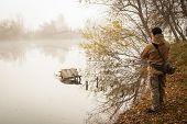 stock photo of fishermen  - Fisherman on the river  - JPG