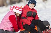 image of snowball-fight  - Children in winter park having fun and playing snowballs - JPG