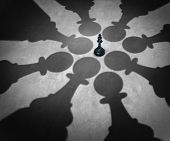 picture of partnership  - Winning together business team symbol teaming up to defeat a powerful opponent with eight chess pawns encircling the competition forming a strong partnership that succeeds over the king as a winning group strategy - JPG