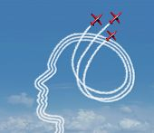 stock photo of achievement  - Personal achievement and career aspiration concept as a group of acrobatic jet airplanes performing an air show creating a human head shape for business vision success or learning potential metaphor - JPG