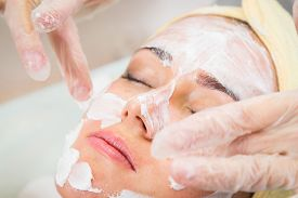 pic of beauty parlour  - Beautiful woman with facial mask at beauty salon - JPG