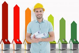 image of house representatives  - Happy male architect holding blueprints against seven 3d houses representing energy efficiency - JPG
