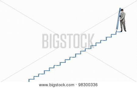 Young businessman drawing ladder with huge pencil