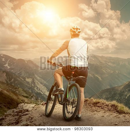 Men with bicycle aroun mountains beautiful view.