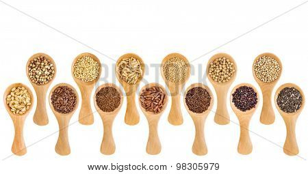 a variety of gluten free grains (buckwheat, amaranth, brown rice, millet, sorghum, teff, black, white and black quinoa, chia seeds, flax seeds) on wooden spoons isolated on white