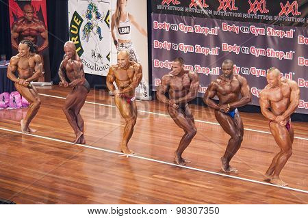 Bodybuilders Showing Their Best Chest Pose In A Lineup Comparison