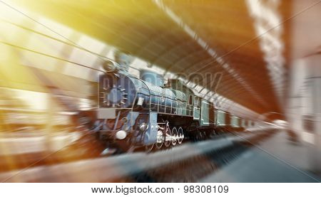 Steam Train Arriving At The Station. Vintage Look.  Motion Blurred Picture.