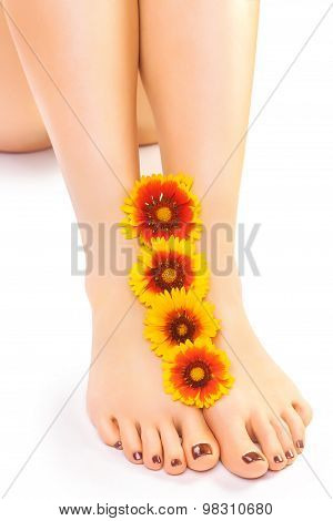 Relaxing pedicure with a orange flower