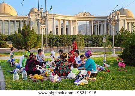 Ashgabad, Turkmenistan - August 1, 2014. Happy Big Family Picnic In The Park. Ashgabad,