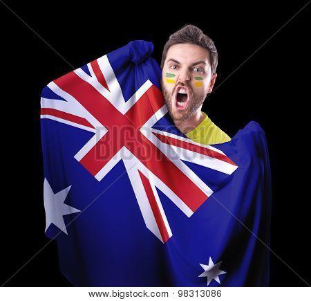 Fan holding the flag of Australia on black background