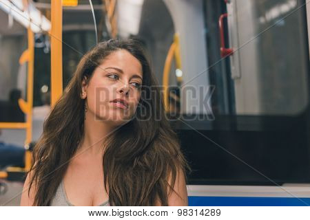 Beautiful Curvy Girl Posing In A Metro Car