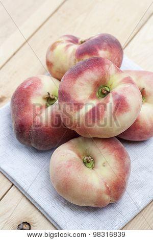 Ripe flat Chinese peaches
