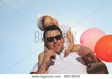 young father with his daughter outdoor on a summer day