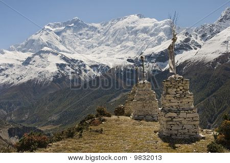 Shrines on the background of snowy peaks in the vicinity of Manang